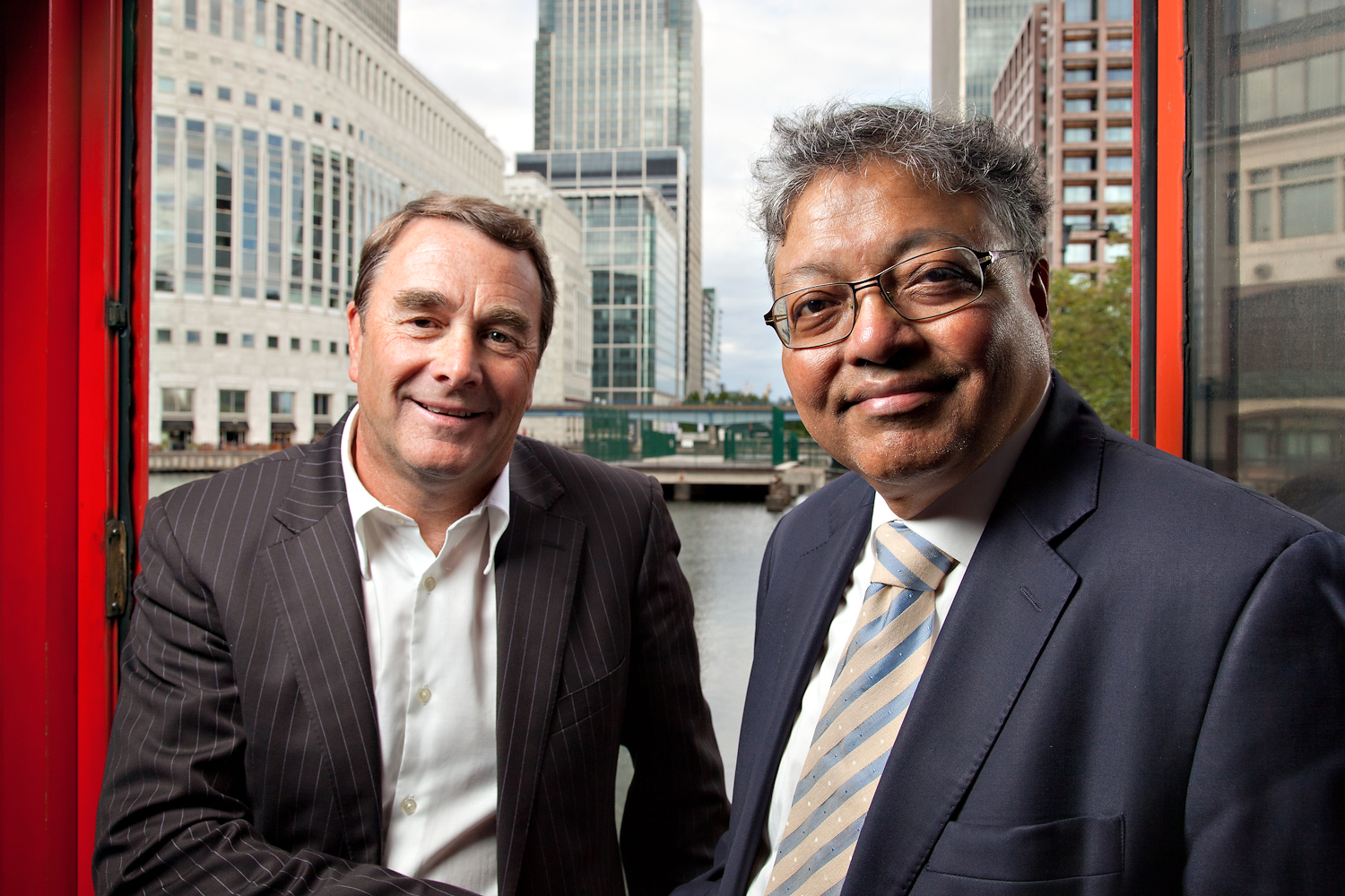 Nigel Mansell, President of the charity UK Youth, with Mihir Bose, journalist